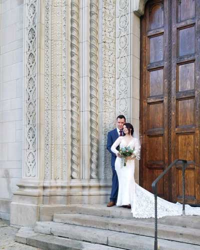 Bride And Groom In Front of Church Door